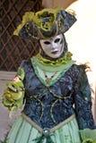 Venetian masquerader (blue) Stock Photography