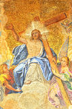 Venetian mosaics. Golden mosaic of Christ Jesus enthroned in paradise bearing the cross and attended by angels. Detail from the basilica of St Mark in Venice Royalty Free Stock Image