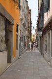 Venetian narrow street Stock Images