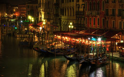 Venetian Night. Night image in Venice on the Grand Canal in the vicinity of the Rialto Bridge Royalty Free Stock Image
