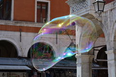 Venetian pillars in an alien-like soap bubble. Venice reflected in an alien-like huge soap bubble, with the play of the sunrays stock photos