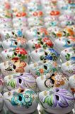 Venetian porcelain masks in line. Coloured porcelain series of venetian masks. Copy space at the top of the image Stock Images