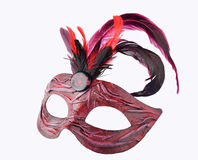 Venetian red Carnival half mask with feathers Stock Photo