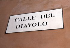 Venetian road sign with text Calle del Diavolo that means Street. VENICE ITALY road sign with text Calle del Diavolo that means Street of the Devil in italian Stock Image