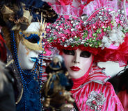 Venetian story. Venice,Italy,February 26th 2011:Close up image of colourful masks during the Canival of Venice.Selective focus on the eyes of the red mask.The royalty free stock photography