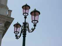 Venetian Street Lamp. Lamp in Venice with pink glass Stock Images