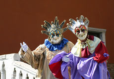 Venetian Street Performers. Two theatrical street performers pose for a photo near Saint Mark's Square in Venice, Italy royalty free stock image