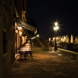Venetian street restaurant at night Stock Images
