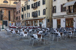 Venetian Terraces. Venice,Italy- February 18, 2012: Big street terraces prepared for clients in a town square in Venice during the Carnival days Royalty Free Stock Image