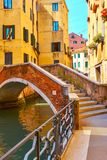 Old small arch bridge over canal in Venice. Venetian view with old small arch bridge over canal, Venice, Italy Royalty Free Stock Photos