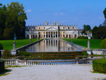 Venetian Villa reflecting in water Royalty Free Stock Image
