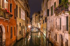 Venetian water сanal at night in Venice. Italy royalty free stock photography