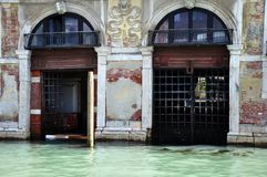 Venetian waterways on the canal. Serve as roadways around the city.A personal entrance is slightly flooded with the rising sea levels royalty free stock image