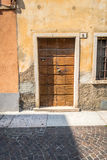 Venetian window, door, arch, architecture from Italy. The colors of Venice and Italy shown in the architectural detail of doors and windows, shutters, doowrways Royalty Free Stock Photo