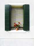Venetian windows with flowers Royalty Free Stock Photography