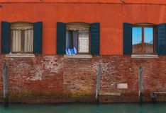 Venetian windows, Italy. Image of typical venetian house facade and windows, Italy Royalty Free Stock Images
