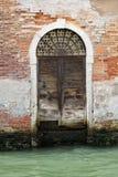 Venetian wooden door Stock Photography