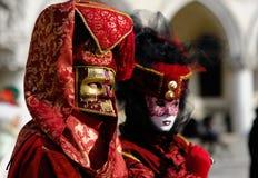Venetianische Karnevalskostüme Stockfoto