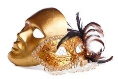 Venetianische Masken auf Weiß Stockfoto