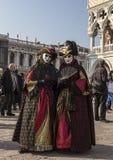 Venetianische Verkleidungen Stockfotos
