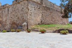 Venetians lion near Famagusta fortress, Cyprus. Venetians lion near old castle tower, Famagusta, North Cyprus Stock Photo