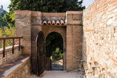 Venetians medieval  Fortress in Brisighella. The brick walls and the entry to the medieval Fortress of Venetians in Brisighella Royalty Free Stock Photos