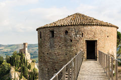 Venetians medieval Fortress in Brisighella. The brickwalls of the medieval Fortress of Venetians in Brisighella. Cultivated fields and the Clock Tower in the Royalty Free Stock Photos
