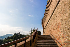 Venetians medieval  Fortress in Brisighella. The stairs and brick walls of the medieval Fortress of Venetians in Brisighella. Church on the background Stock Photography