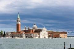 Venezia - Basilica di San Giorgio Maggiore. Basilica di San Giorgio Maggiore kissed by sun with cloudy sky royalty free stock image