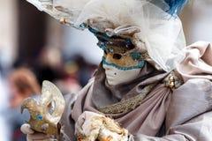 Venezia carnival art artist dress suit beauty mask face mistery sorrow royalty free stock photo