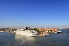 Venezia and the cruise ships. A panoramic view of Venice together with a big cruise ship docked, Venice, Italy royalty free stock images