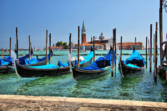 Venezia-gondola. The Venice embankment in Italy with a view of the old boats - gondola Stock Image