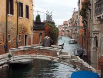 Venezia, Italy: Bridge over a Venetian canal stock photos