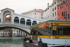 Water bus station Rialto bridge, Venice, Italy. Venezia, Italy - Mar 8, 2017 :  Water bus station `Rialto` near Rialto bridge in the early morning, Venice, Italy Stock Image
