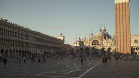 VENEZIA - JULY 14: Left to right pan real time establishing shot of St Mark`s Square with tourists. St Mark`s Square is stock video