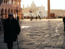 Romantic Venice.Square San Marco. Italy Venice square San Marco morning romantic place lanterne background church walking passer-by old man 9 December 2012 Stock Photo