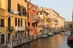 Venezia/ Sunset view of the river canal and traditional venetian architecture. Venice / Sunset view of the river canal and traditional venetian architecture Royalty Free Stock Images