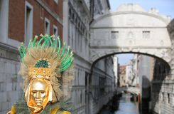 Venezia, VE, Italy - February 5, 2018: Person with Mask and Bridge of Sighs royalty free stock image