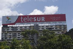 Venezuela,Caracas.Advertising on a fence in a building of the television network Telesur.  stock images