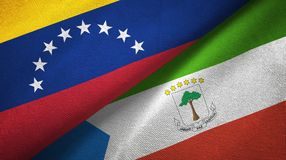 Venezuela and Equatorial Guinea two flags textile cloth, fabric texture. Venezuela and Equatorial Guinea two folded flags together vector illustration