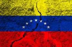 Venezuela flag on the background texture shabby paint with a crack on the whole frame. Horizontal frame royalty free stock photos
