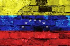 Venezuela flag on a brick wall background with broken plaster. Horizontal frame stock image