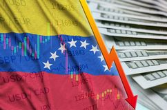 Venezuela flag and chart falling US dollar position with a fan of dollar bills. Concept of depreciation value of US dollar currency royalty free stock photography