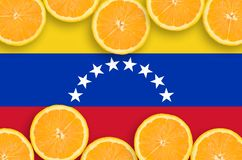 Venezuela flag in citrus fruit slices horizontal frame. Venezuela flag in horizontal frame of orange citrus fruit slices. Concept of growing as well as import stock illustration