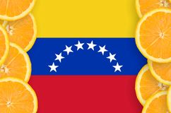 Venezuela flag in citrus fruit slices vertical frame. Venezuela flag in vertical frame of orange citrus fruit slices. Concept of growing as well as import and royalty free illustration