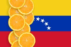 Venezuela flag and citrus fruit slices vertical row. Venezuela flag and vertical row of orange citrus fruit slices. Concept of growing as well as import and stock illustration