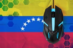 Venezuela flag and computer mouse. Concept of country representing e-sports team. Venezuela flag and modern backlit computer mouse. Concept of country royalty free stock photos