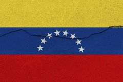 Venezuela flag on concrete wall with crack stock photography