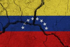 Venezuela flag on the cracked earth stock image
