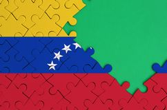 Venezuela flag is depicted on a completed jigsaw puzzle with free green copy space on the right side.  vector illustration